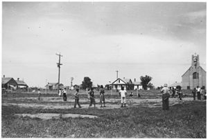 Group of Indian children playing baseball, village in background. - NARA - 285572.jpg
