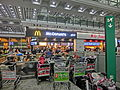 HK Intrenational Airport Terminal 香港國際機場 restaurant McDonalds shop sign Oct-2013 baggage carts.JPG