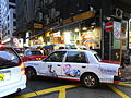 HK Sheung Wan Wing Lok Street rain evening Taxi body ads Saint Honore Moon Cake Shop July-2012.JPG