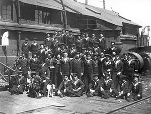 Newfoundland Royal Naval Reserve - Members of the Newfoundland Royal Naval Reserve in front of their ship, HMS Calypso, wharfside at St. Johns. Provincial Archives of Newfoundland and Labrador