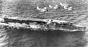 Courageous-class aircraft carrier - Furious in the mid-1930s with a flight of Blackburn Baffin torpedo bombers overhead