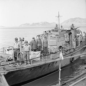 HMS Kimberley (F50) - The German delegation, aboard a captured British motor launch, come alongside Kimberley to formally surrender