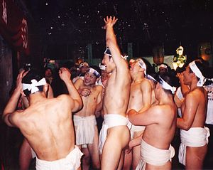 Fundoshi - Participants receiving purification by water at the naked festival in Okayama.