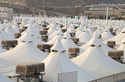 Tents in Mina city (Saudi Arabia), just 2 kilometres (1.2 mi) away from Mecca. The tents are air conditioned with evaporative cooling units made in Australia. Haji pilgrimage mina tent city.jpg