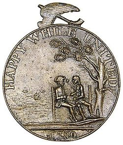 "Reverse of ""Happy While United"" medal"