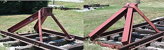 Buffer stop - Two views of a Hayes-built bumper at the Linden Railroad Museum, Linden, Indiana. This design accommodates the AAR coupler.