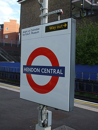 Colindale tube station - Roundel on southbound platform face at Hendon Central, advising passengers for the Royal Air Force Museum to alight at Colindale