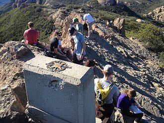 Sandstone Peak - A group of hikers atop the summit of Sandstone Peak
