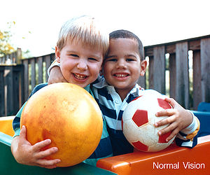 Human eyesight two children and ball normal vi...