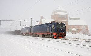 Kiruna - An Iore-hauled train passing Vassijaure