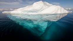 Iceberg in the Arctic with its underside exposed, brightened underwater.jpg