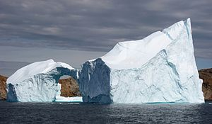 Iceberg with hole near Sanderson Hope, Greenland.