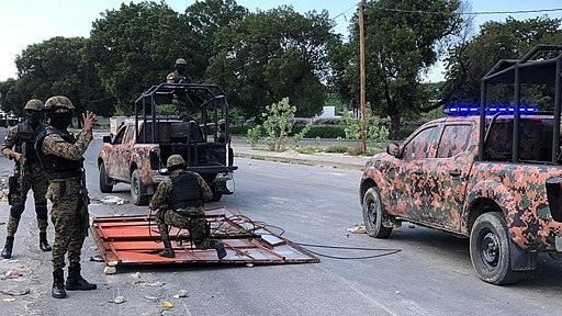 Haiti's National Police guard remove makeshift barricades made of steel fences and tree branches protesters placed to block the National Palace entrance, Oct. 31, 2019. (Photo: Matiado Vilme / VOA -- Public Domain)