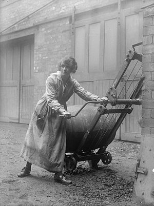 Bowling Iron Works - A female worker demonstrates an elevating device for barrels at the Bowling Iron Works, Bradford, in November 1918.