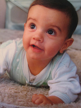 As an infant's vision develops, he or she may seem preoccupied with watching surrounding objects and people.