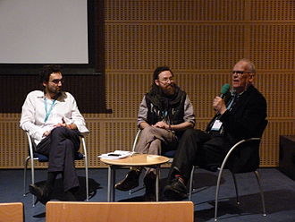 Panel discussion with Greenlandic movie maker Inuk Silis Hoegh at the launch of his movie about groundbreaking Greenlandic band Sume Inuk Silis Hoegh, Tommi Kainulainen - WOMEX 15, Budapest, 2015.10.22 (1).JPG