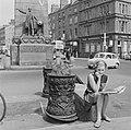 Ironwork bollards in Dublin, and Parnell Monument (1969).jpg