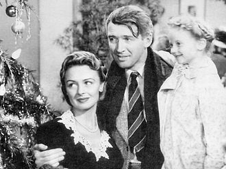 Christmas by medium - Donna Reed, Jimmy Stewart and Karolyn Grimes in the American film It's a Wonderful Life