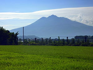 Mount Iwaki stands prominently to the southwest