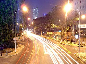 Ampang, Kuala Lumpur - The busy Ampang Road at night leading straight to the Petronas Twin Towers.