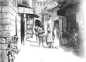 Jenin - Street scene in Jenin, 1917. An Ottoman Army soldier (center left) with a local resident (center right)