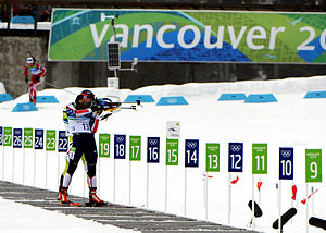 Jeremy Teela - Teela shoots from the standing position in the men's sprint at the 2010 Winter Olympics.