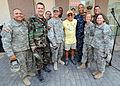 Jimmy Buffet poses for a photograph after performing for members of Joint Task Force Haiti March 3, 2010, behind the U.S. Embassy in Port-au-Prince, Haiti 100303-N-HX866-007.jpg