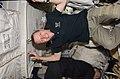 Johnson Posing for a Photo on the Shuttle Atlantis Middeck (27561247784).jpg