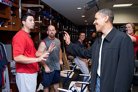 Youkilis (center), Josh Beckett (left), and Barack Obama before the start of the Major League Baseball All-Star Game, July 2009 Josh Beckett Kevin Youkilis Barack Obama.jpg