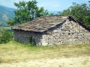 Roof pitch - Some types of stone roofs have a very restrictive roof pitch, too low a pitch the roof will leak, too much pitch the loose stones will slide off.