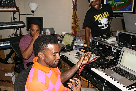 West working in the studio in 2008, accompanied by mentor No I.D. (left). Kanye West in the Studio.jpg
