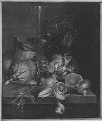 Still life with a 'roemer' and a flute glass on a stone ledge