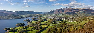 Walking in the United Kingdom - Skiddaw mountain, the town of Keswick, Cumbria and Derwent Water seen from Walla Crag, Lake District, England.
