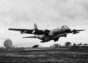 Low-altitude parachute-extraction system - C-130 Hercules dropping pallet with Low Altitude Parachute Extraction System on Khe Sanh runway.