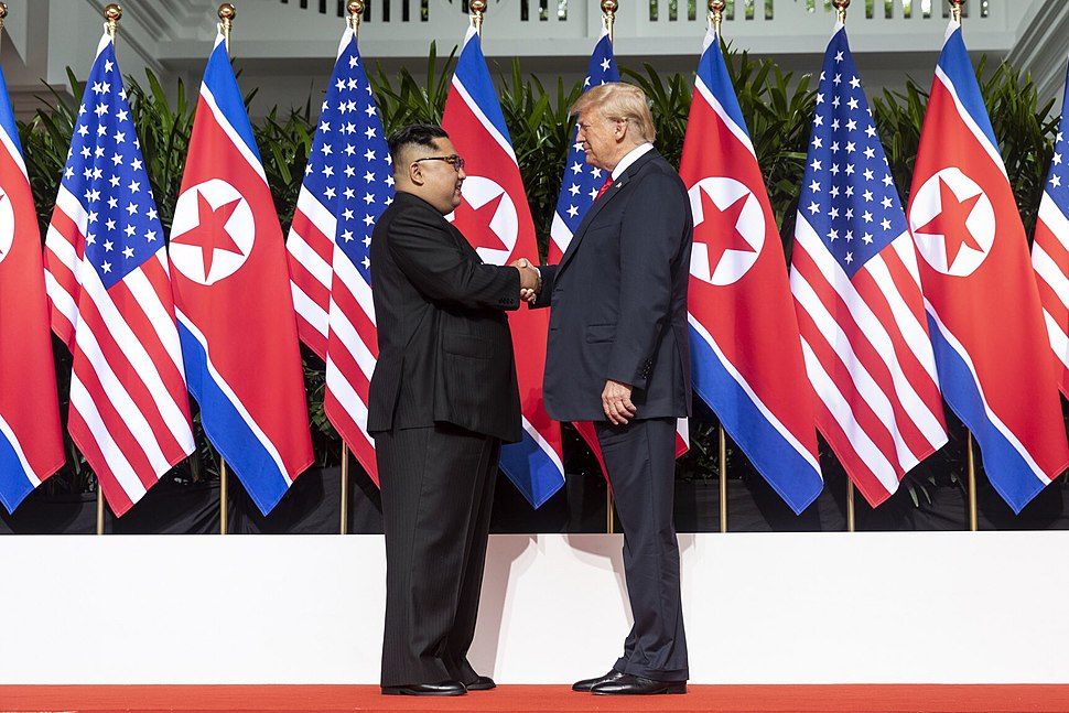 Kim and Trump shaking hands at the red carpet during the DPRK–USA Singapore Summit