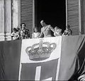 King Umberto II behind of the Flag of Kingdom of Italy.jpg