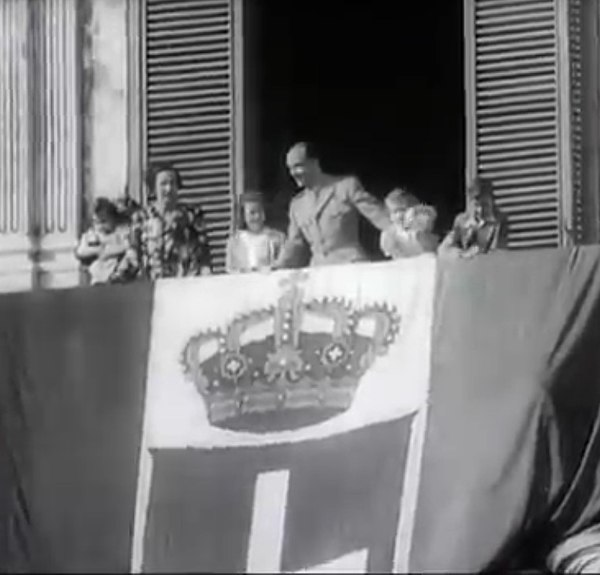 King Umberto II behind of the Flag of Kingdom of Italy King Umberto II behind of the Flag of Kingdom of Italy.jpg