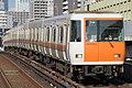 Kintetsu 7124 at Kujo Station.jpg