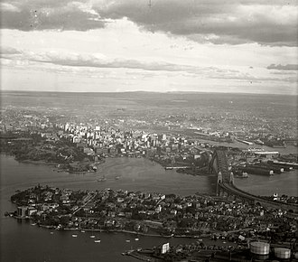 Kirribilli, New South Wales - The Sydney city centre behind Kirribilli, at foreground. The two regions were linked by the opening Harbour Bridge.