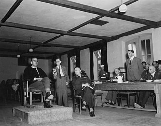 """Georg Konrad Morgen - June 10, 1947. """"10 June. L/r: Defense witness, Dr. Morgen; German radio reporter, Werner Klein; interpreter, Rudolph Nathanson, WDC; and defense attorney, Dr. Wacker. Dr. Morgen was an investigator who came to Buchenwald to investigate Commander Koch, who was in charge at the time. As a result of Dr. Morgen's investigation Koch was arrested and executed. Dr. Morgen is also a prisoner at Dachau."""""""