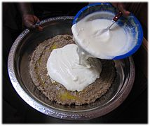 Lakh - arraw millet porridge 3. fermented milk topping.jpg