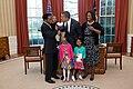 Lauren Fleming looks up as her brother Corbin touches President Barack Obama's face, 2012.jpg