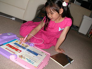 Educational toy - A girl with LeapPad
