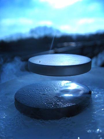 A superconductor levitating a permanent magnet