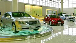 The LS and other Lexus vehicles on showroom display.