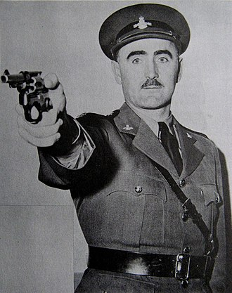 British Columbia Provincial Police - BCPP officer Jack Henry posing with a revolver.