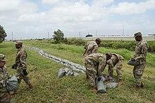 Louisiana National Guard placing sandbags along a levee in Louisiana