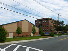 Lowell Catholic High School; gym and main building viewed from north; Lowell, MA; 2011-09-11.JPG