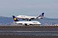 Lufthansa Airbus A380-841 D-AIMJ and United Airlines Boeing 747-400 N127UA (16673368660).jpg