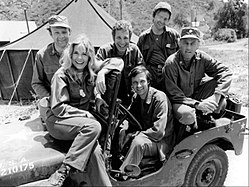 The cast of M*A*S*H (1974); clockwise from left: Larry Linville, Loretta Swit, Wayne Rogers, Gary Burghoff, McLean Stevenson, and Alan Alda.